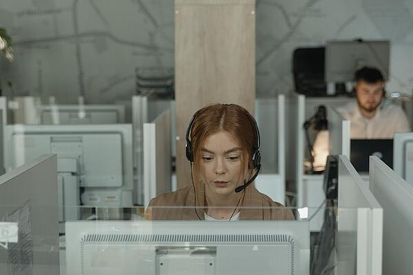 Woman with headset at a contact center