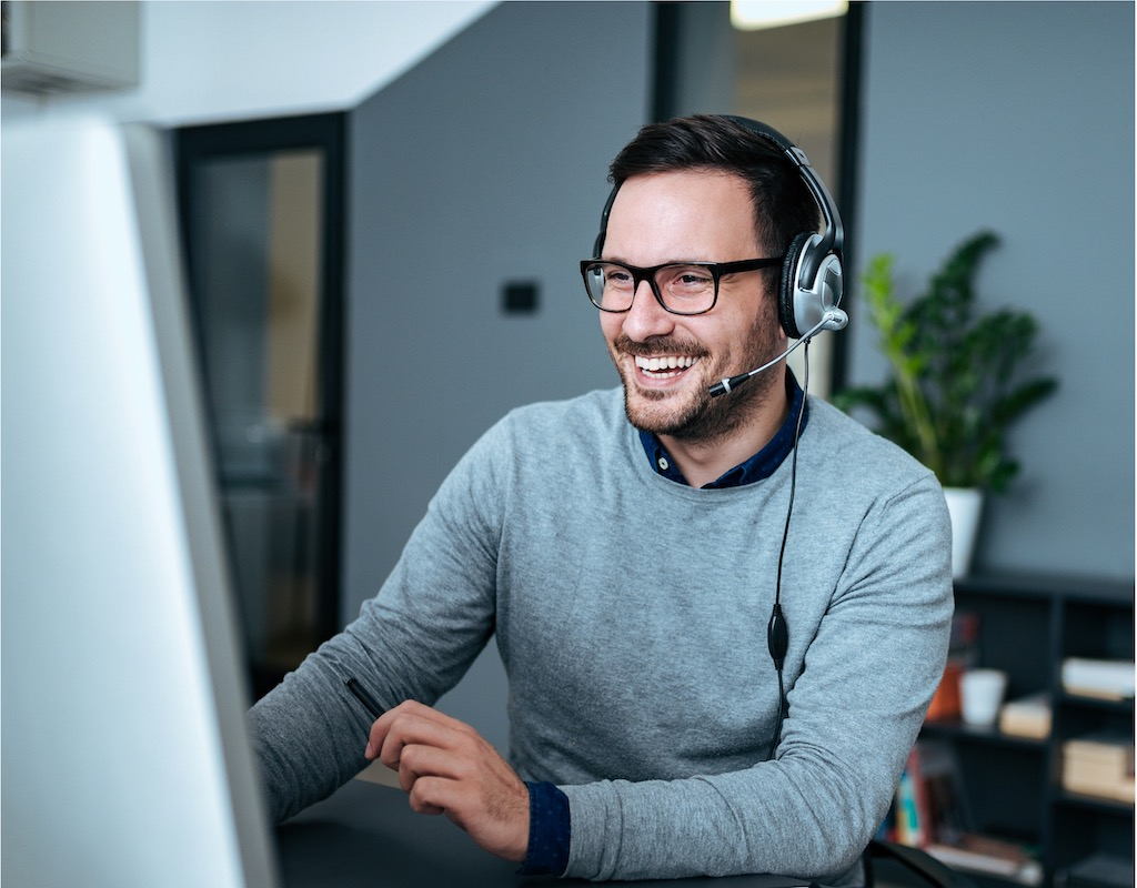 Man with a headset at a contact center