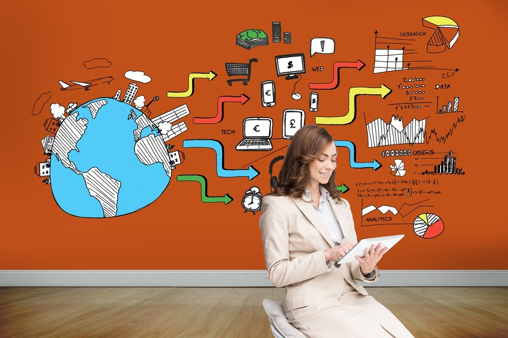 Composite image of pleased businesswoman using a tablet pc sitting on chair in front of orange wall showing economic illustrations