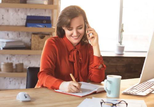 woman-talking-on-phone-in-office